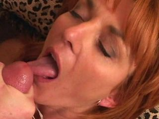 Sexy lovely redhead swallows load of cum