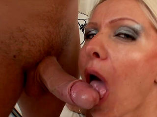 Sweet blonde milf is swallowing a big cock