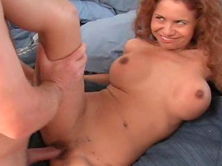 Curlyhaired milf is giving a deep blowjob