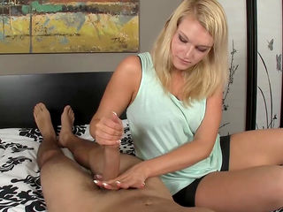 Slick blonde is wanking this nice dong